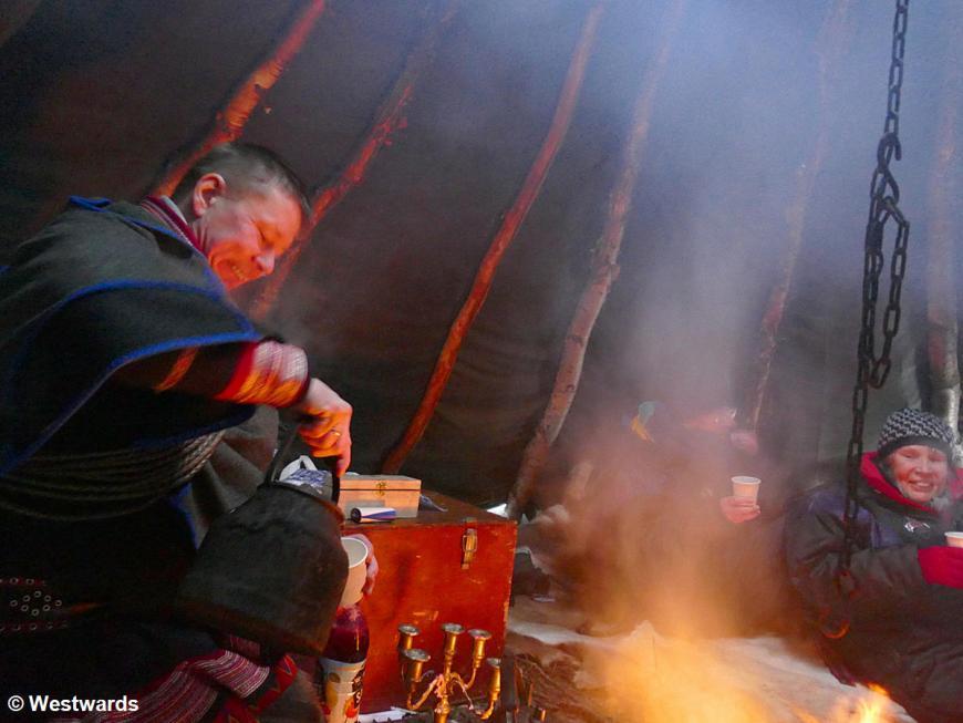 Tourist taking a break at a sami tent