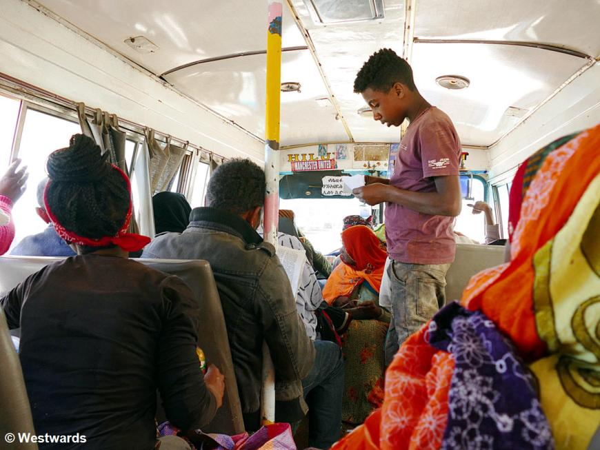 Juvenile conductor at a bus travelling in Eritrea