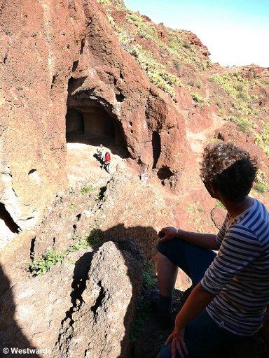 Visitors in the prehistoric caves of Cuatros Cuevas, Gran Canaria