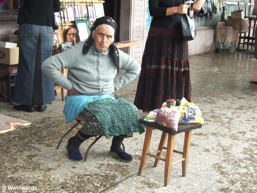 Woman selling peanuts in Kutaisi, Georgia
