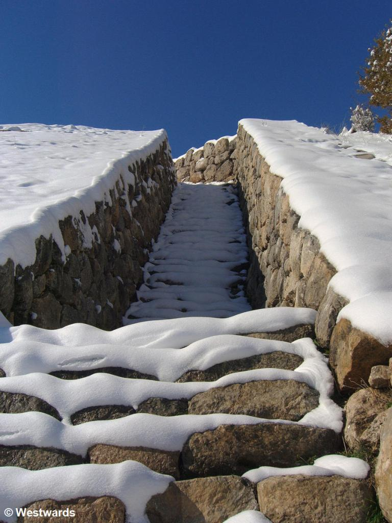 Snow-covered stone steps at the gate of the Sphinxes in Hattusha