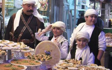 Family selling sweets in Damascus