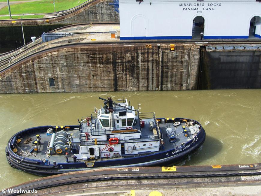 Tow boat in the Miraflores Locks of the Panama Canal