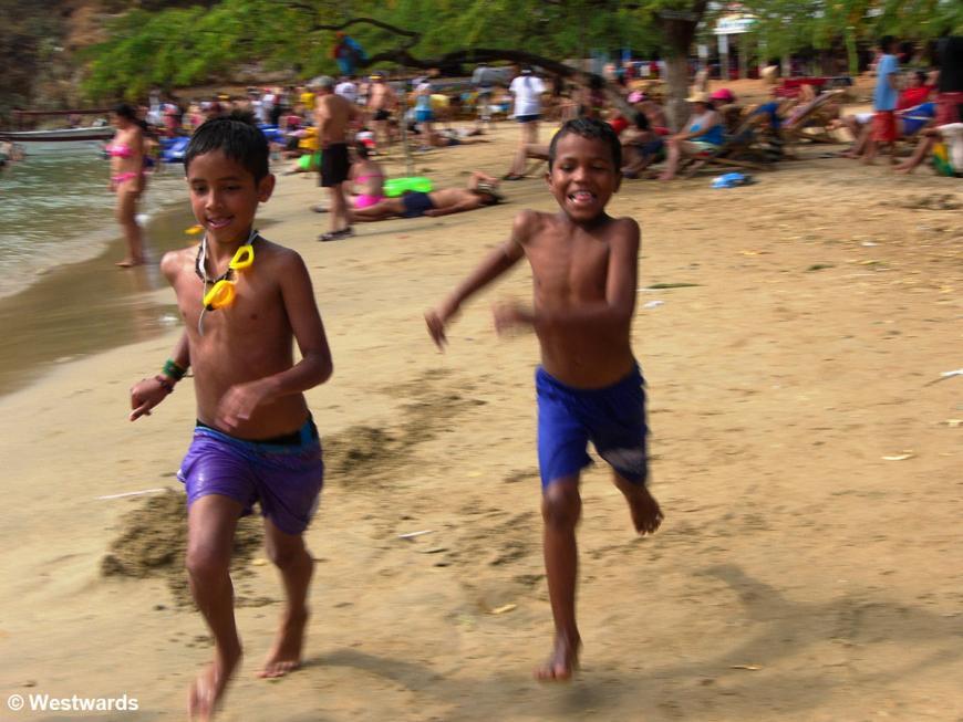 Children running on Taganga Playa Grande