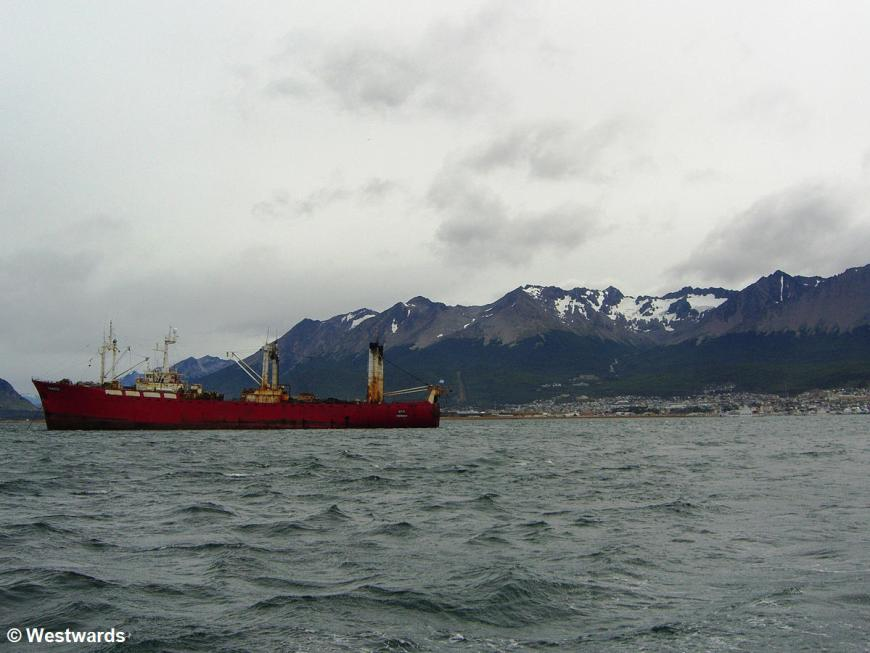 Beagle Channel with ship, mountains, and Ushuaia