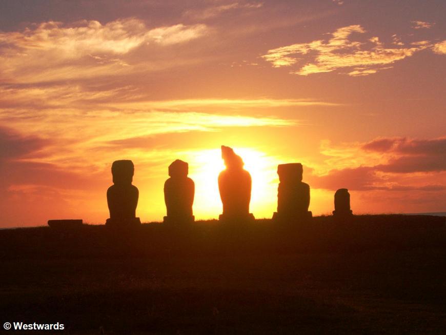 sunset behind Vai Uri Moai sculptures in Hanga Roa, Easter Island