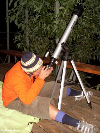 Isa star gazing with a telescope at Astro Lodge in Elqui Valley, Chile
