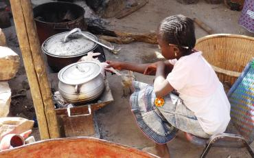 Girl cooking at an outdoor kitchen