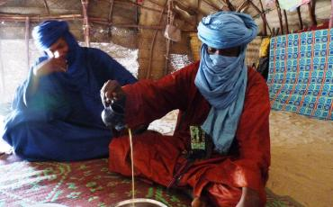 Tuareg pouring tea in a tent