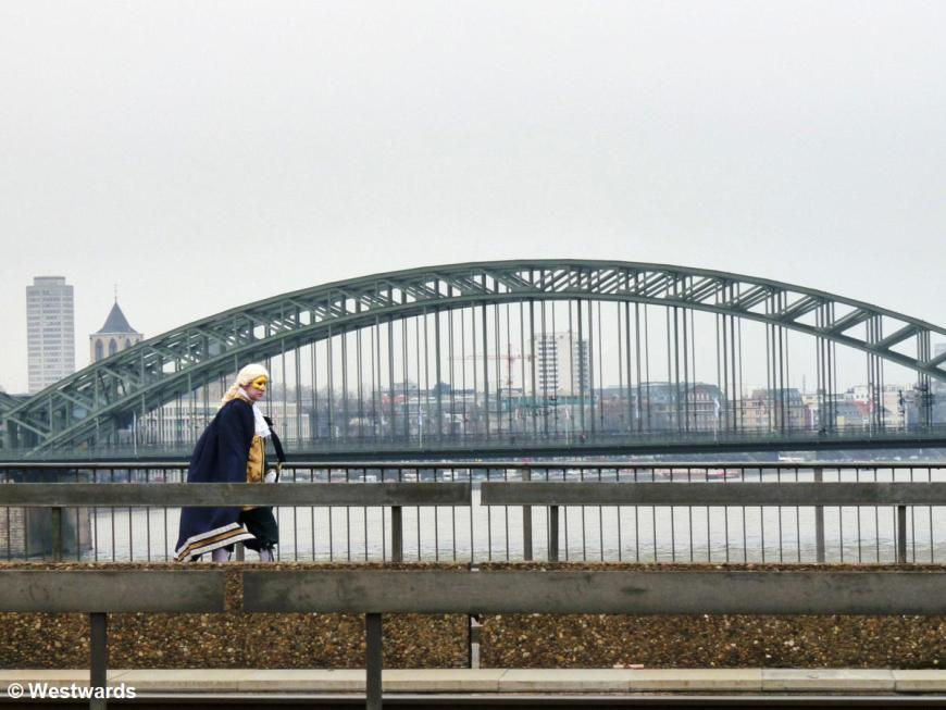 Man in baroque costume on a bridge in Cologne