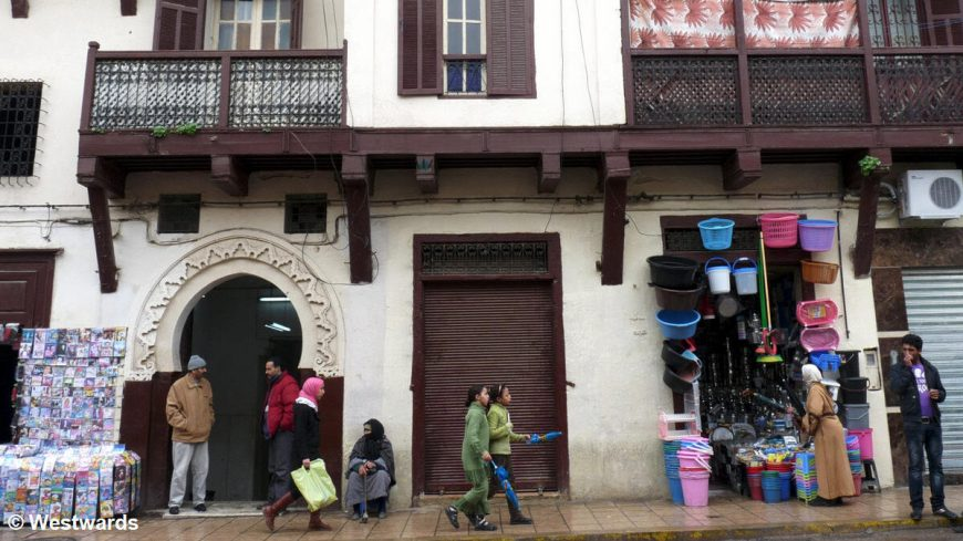 Fes (Morocco) after the rain, people with umbrellas