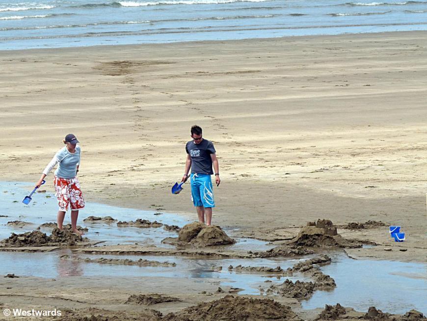 couple building sand castles