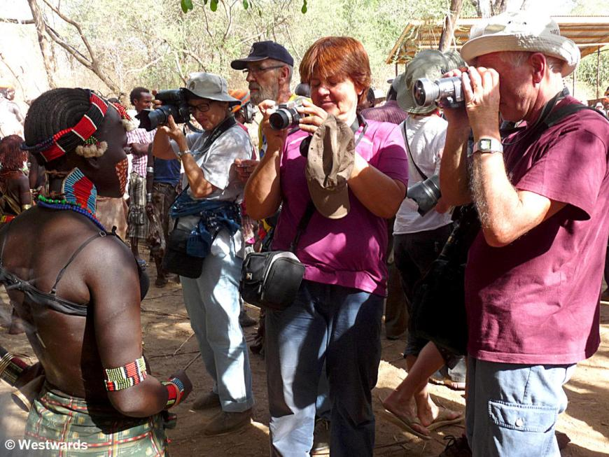 tourists visiting a Hamer celebration in the Omo valley