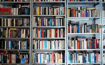 Book shelf full of books - no Kindle!