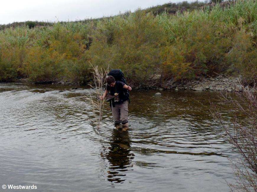 Natascha hiking the Via Algarviana: here wading through a stream