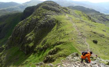 Hker climbing down a hill in the Lake District