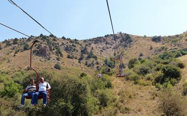 Gondola with tourists at the Big chairlift in Chimgan