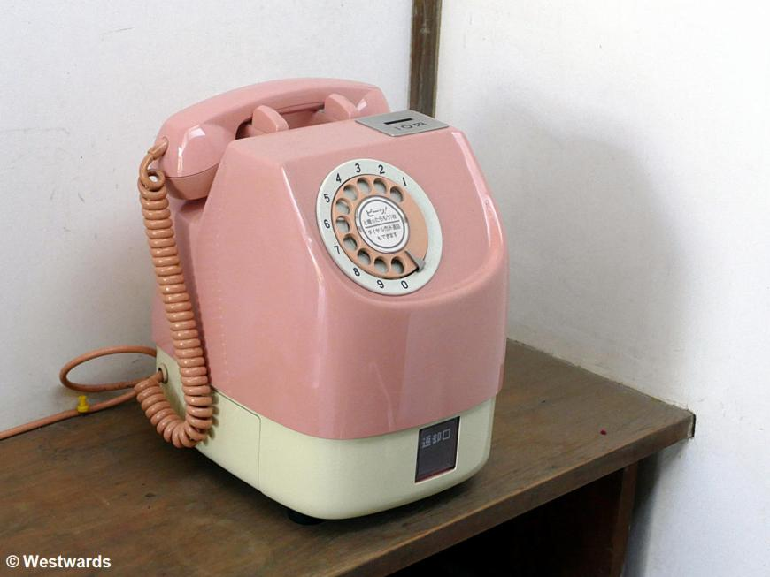 Old pink rotary telephone in Kyoto