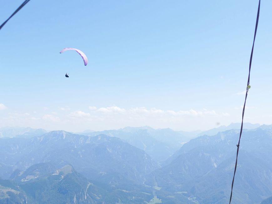 Paraglider high above the Gesaeuse mountains, Austria