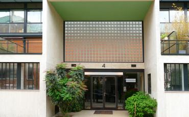 The high, cubic entrance portico of Maison Clarte by Le Corbusier