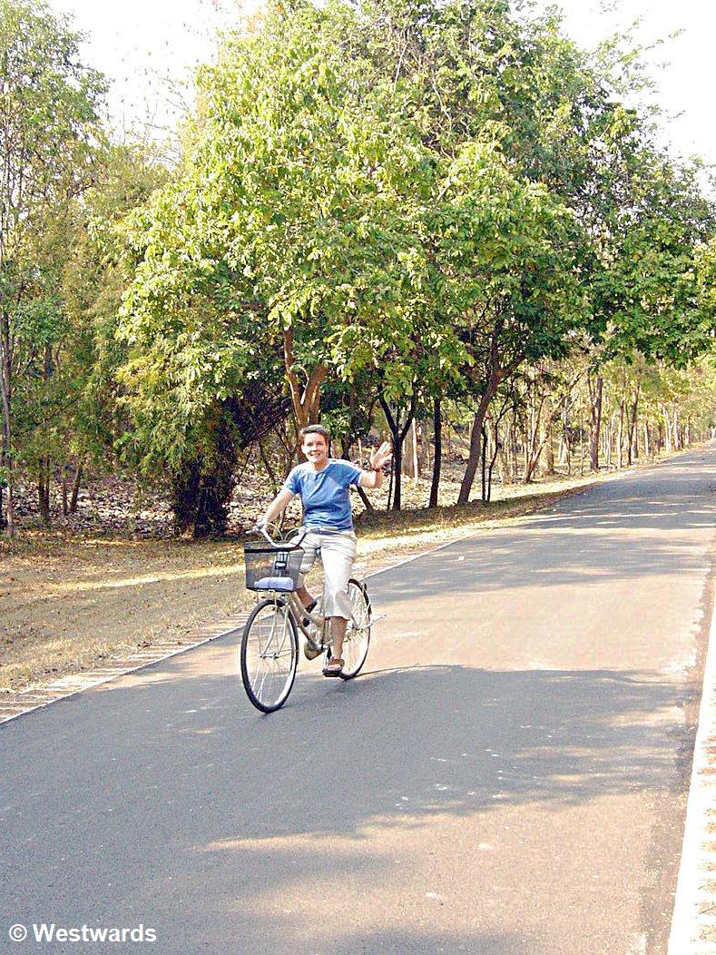 traveller on a bicycle near Sri Sachanalai in Thailand