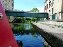 Saltaire. Mill buildings from the Leeds Liverpool Canal. 2015.