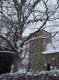 church and tree in snow