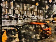 Cars through wet window. Impressive art.