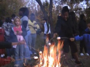 roasting marshmallows at the camp fire