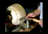 Bowl maker Wes Kolkmeier of St. Charles uses a 1/4-inch bead forming tool to add decorative rings to a bowl.