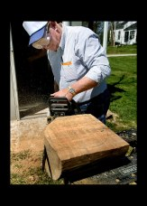 After drawing a circle on the log, bowl maker Wes Kolkmeier, 63, of St. Charles uses a chain saw to cut away excess wood around the circle to give the bowl its basic shape.