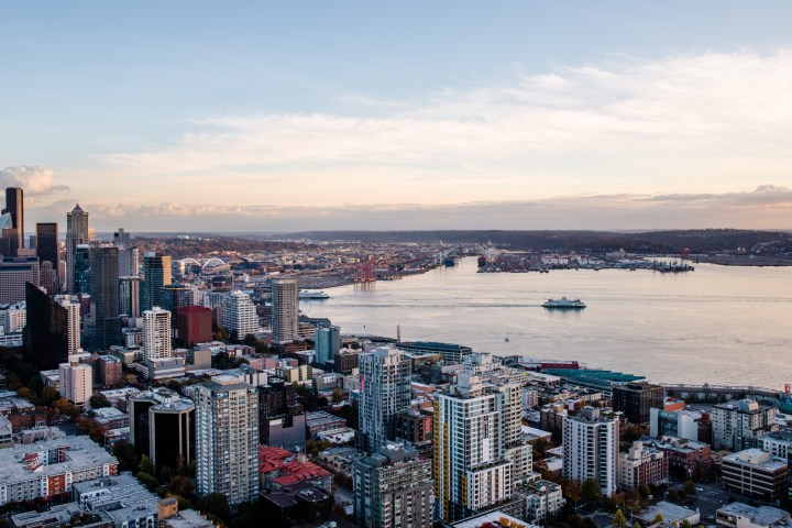 Ferry boat leaving Downtown Seattle crossing the Puget Sound, view from the Space Needle.