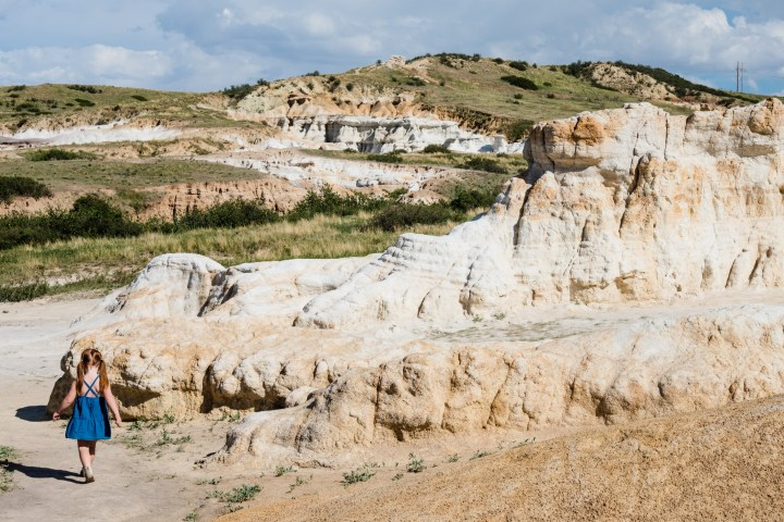 little girl with red hair walking down hill into Paint Mines Interpretive Park in Calhan, Colorado