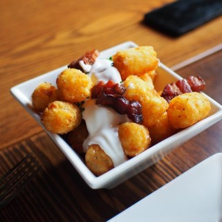 Tater Tots w/ Sour Cream, Bacon & Chives at Modern Steak