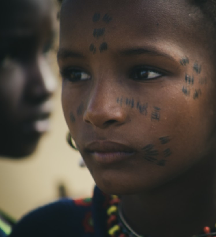 Scarification and tattooing begin at an early age.