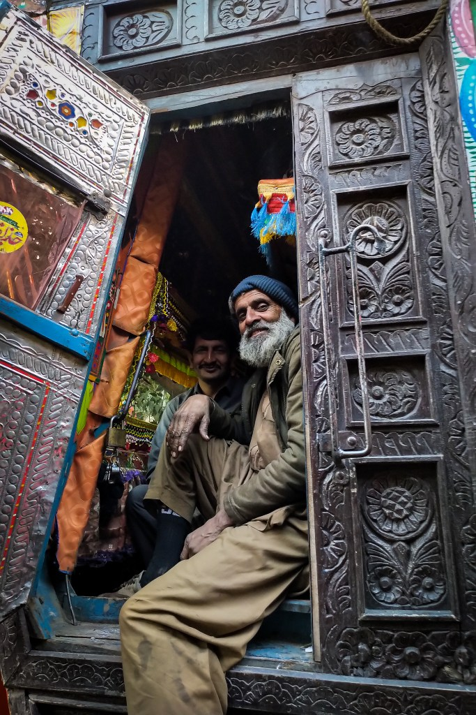Pakistan Travel - welcoming faces at the truck painting yard.