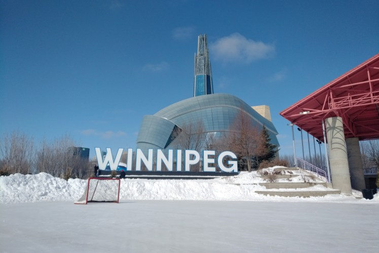 Travel Winnipeg and Manitoba - ice hockey rink at The Forks in the winter.