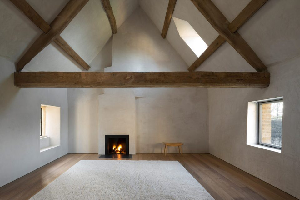 minimal bedroom with chimney and wood structure