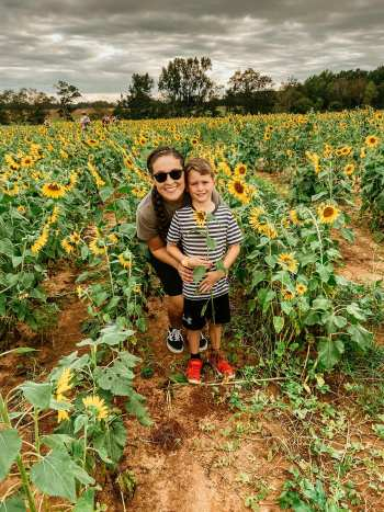 Wewa Films | A woman and her son in a field of sunflowers