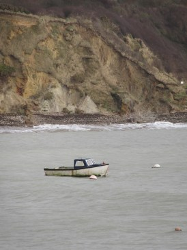 Lonely boat in Lulworth Cove