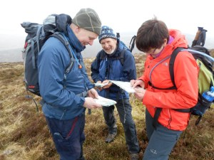 TJ and Helen confirming their location, closely monitored by Greg Kenny, instructor (Peaks club).