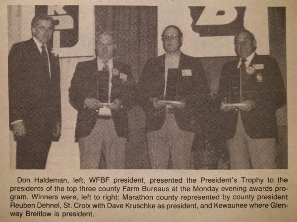 Past WFBF President Don Haldeman presented the President's Trophy at the 1983 Annual Meeting.