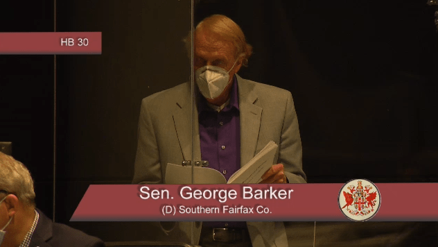 "Sen. George Barker, D-Fairfax, wore a mask and sat inside a plexiglass structure that lawmakers jokingly called ""the cage."" CNS"