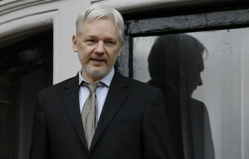 Wikileaks founder Julian Assange speaks from the balcony of the Ecuadorean Embassy in London in February 2015.