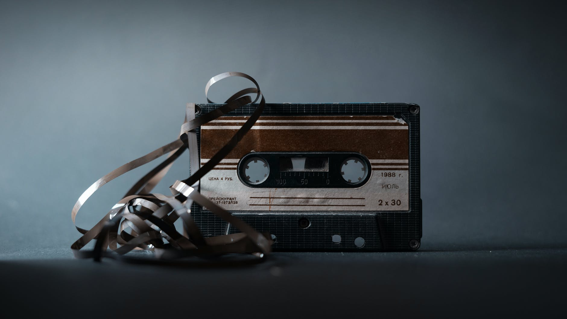 retro cassette with tape on gray background