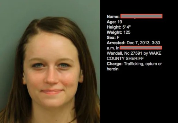 Awfully happy for a mug shot.