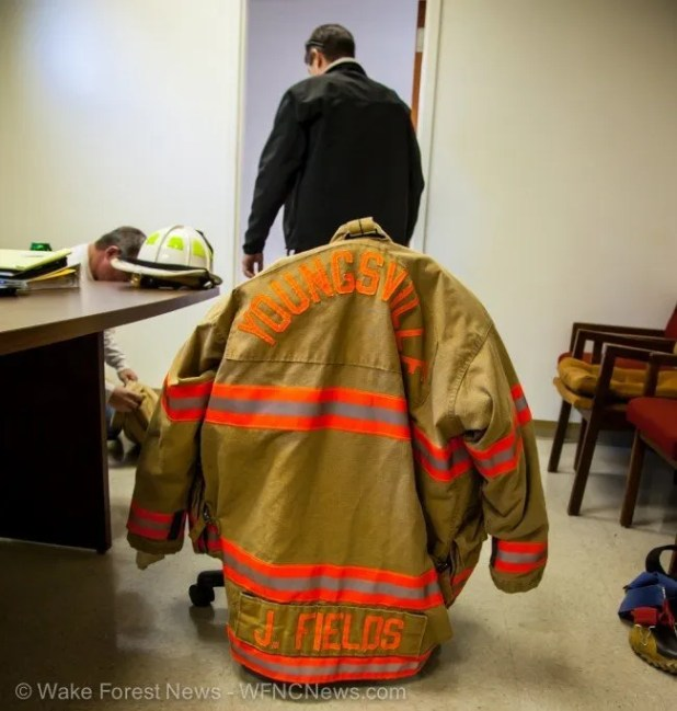 The coat of Jeff Fields sits readied for the memorial to be held at the Youngsvill Fire Department on Saturday.