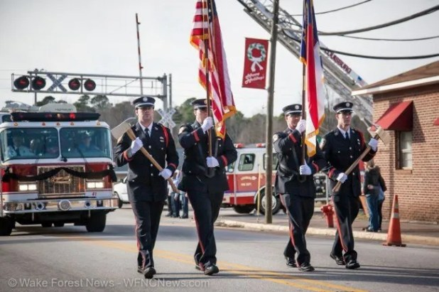 Firefighter honor guard leads Truck 41 on final route.