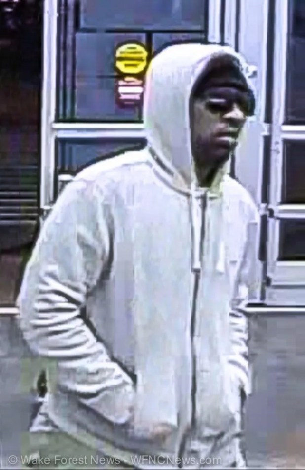 Wake Forest Walmart Money Center suspected robber entering store.