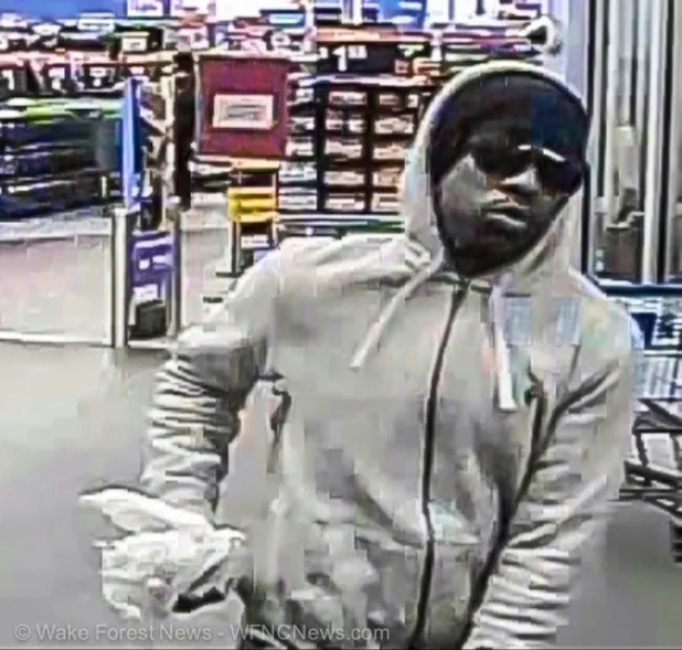 Wake Forest Walmart Money Center suspected robber leaving store.